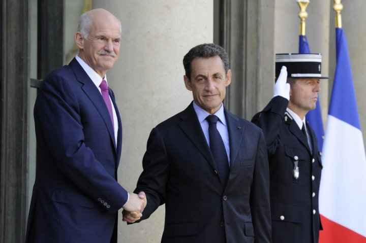 France's President Sarkozy greets Greek Prime Minister Papandreou on the steps of the Elysee Palace in Paris