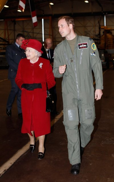 Britains Queen Elizabeth talks with her grandson Prince William after being shown around a Sea King search and rescue helicopter during a visit to RAF Valley in north Wales