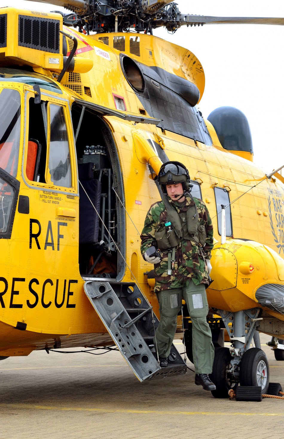 Britain's Prince William disembarks a Sea King helicopter at RAF Valley on Anglesey, in Wales