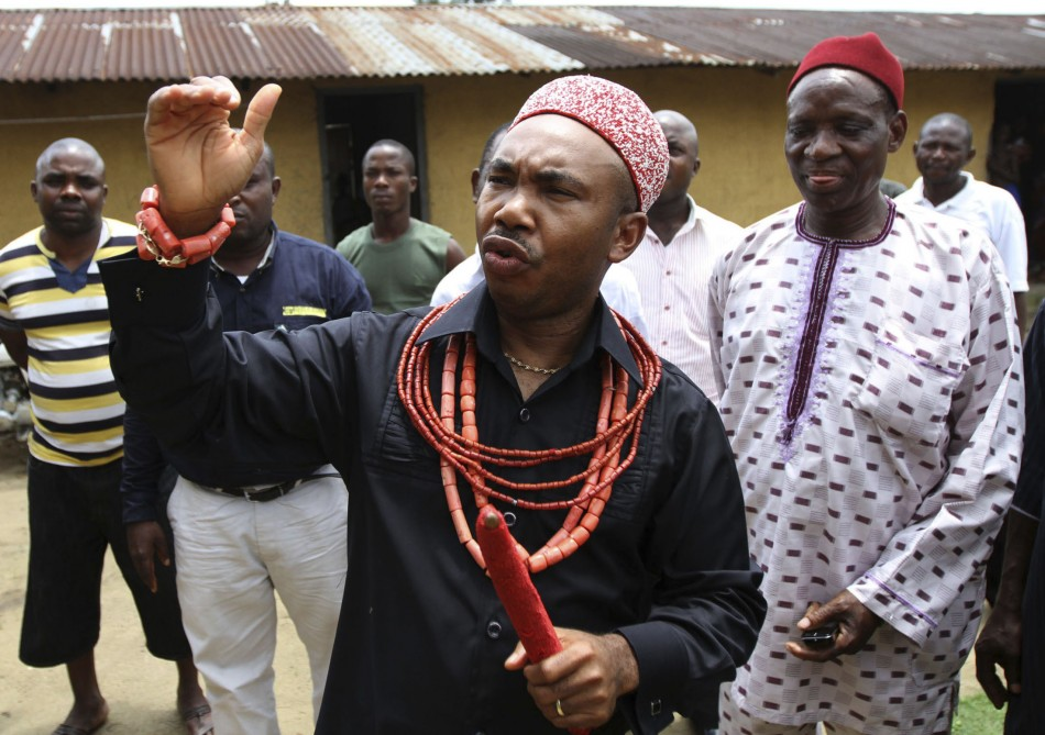 Suanu Baridam, secretary of the Ogoni Council of Traditional Rulers, speaks to Reuters outside his palace at Ogoniland, Nigeria's delta region August
