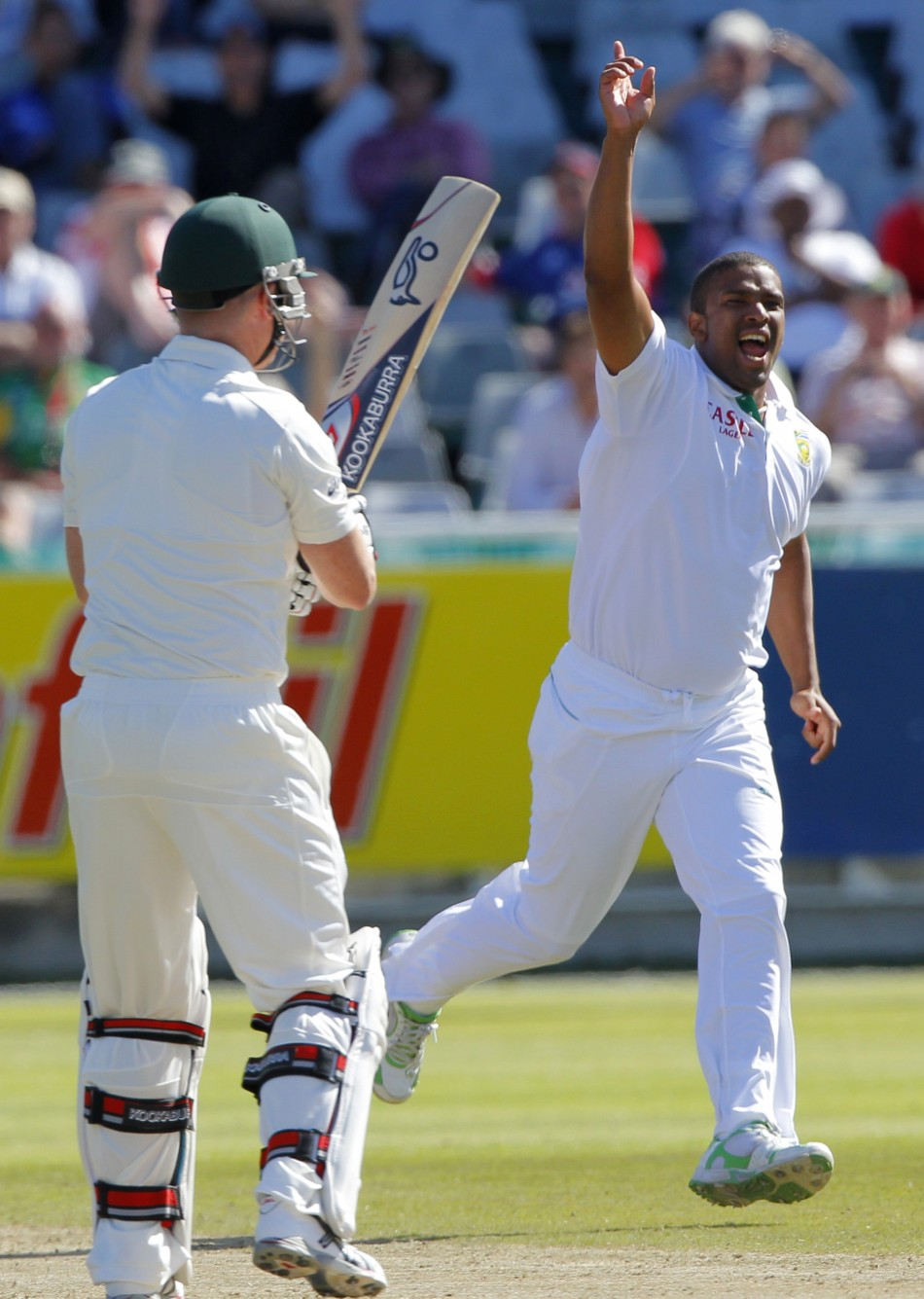 South Africa's Vernon Philander celebrates after taking the wicket of Australia's Brad Haddin during the second day of their first test cricket match in Cape Town.