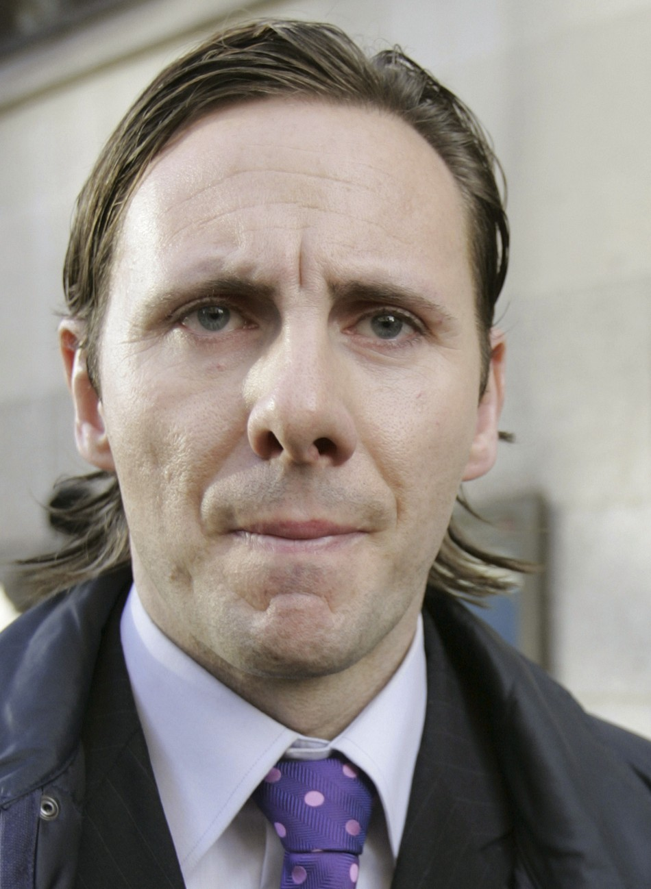 Private investigator Mulcaire leaves the Old Bailey court in central London