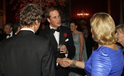 William greets a lady at the event