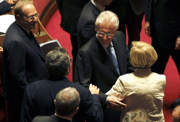 Former European Commissioner Monti is greeted by senators as he arrives at the Senate in Rome