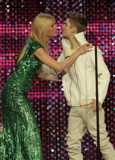 Actress Gwyneth Paltrow hugs Canadian singer Justin Bieber R as he received the Entertainment Bambi award during the 63rd Bambi media awards ceremony in Wiesbaden