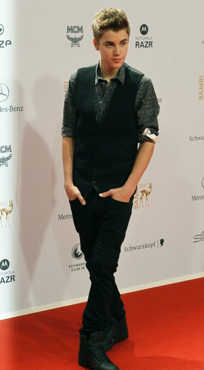 Canadian singer Justin Bieber arrives on the red carpet for the 63rd Bambi media awards ceremony in Wiesbaden