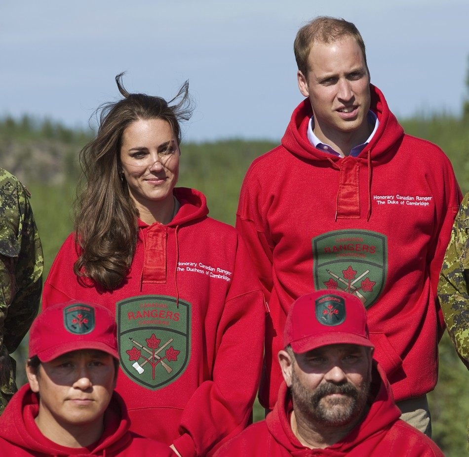 Britains Prince William and his wife Catherine pose wearing the sweaters of the Canadian Rangers during a visit to Blatchford Lake