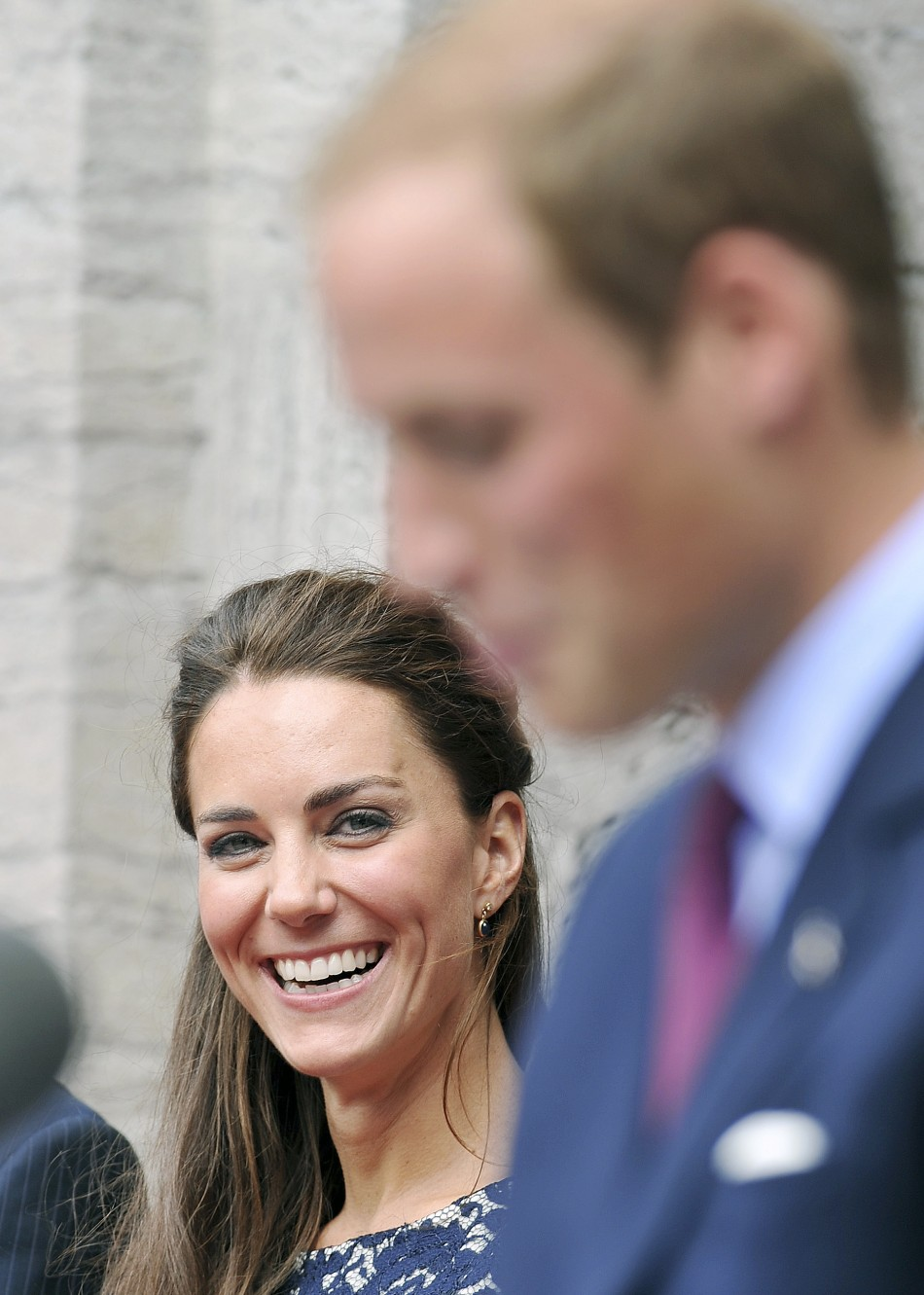 Britains Catherine, Duchess of Cambridge laughs as her husband Prince William speaks outside the official residence of the Governor General of Canada, Rideau Hall in Ottawa