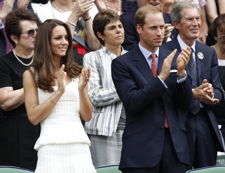 Britain's Prince William and his wife, Catherine, Duchess of Cambridge applaud after Andy Murray of Britain defeated Richard Gasquet of France, on Centre Court at the Wimbledon tennis championships in London