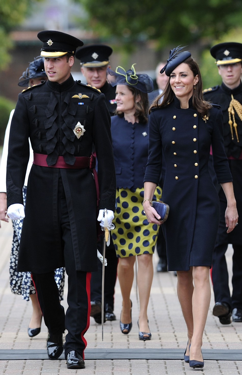 Britains Prince William and his wife Catherine, Duchess of Cambridge visit Victoria Barracks to present medals to the Irish Guards in Windsor