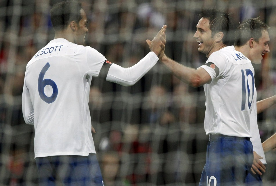 England's Frank Lampard (R) is congratulated by teammate Joleon Lescott after scoring a goal against Spain during their international friendly soccer match at Wembley
