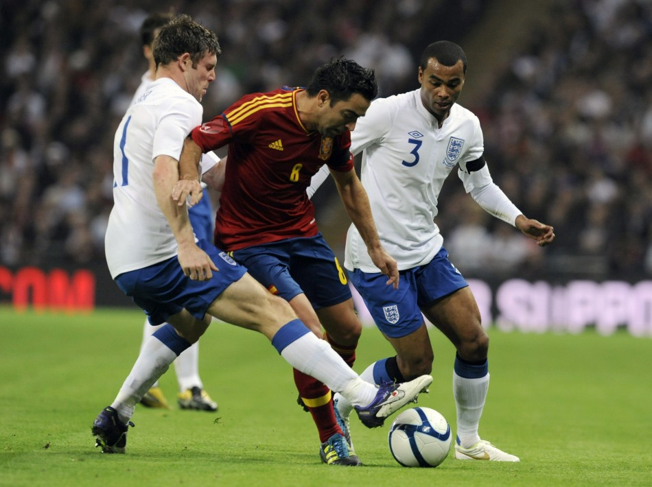 England's Milner and Cole challenge Spain's Xavi during their international friendly soccer match in London