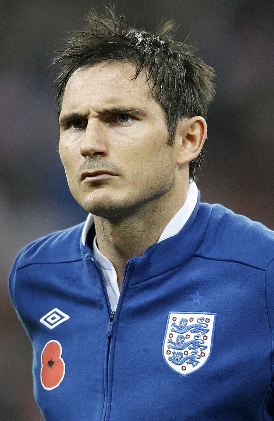 England's Lampard lines up for the national anthems before their international friendly soccer match against Spain at Wembley Stadium in London