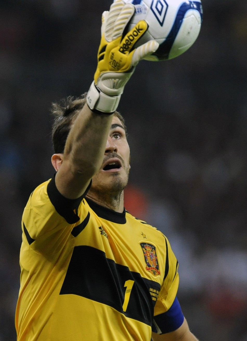 Spain's Casillas catches a ball before his international friendly soccer match against England at Wembley Stadium in London