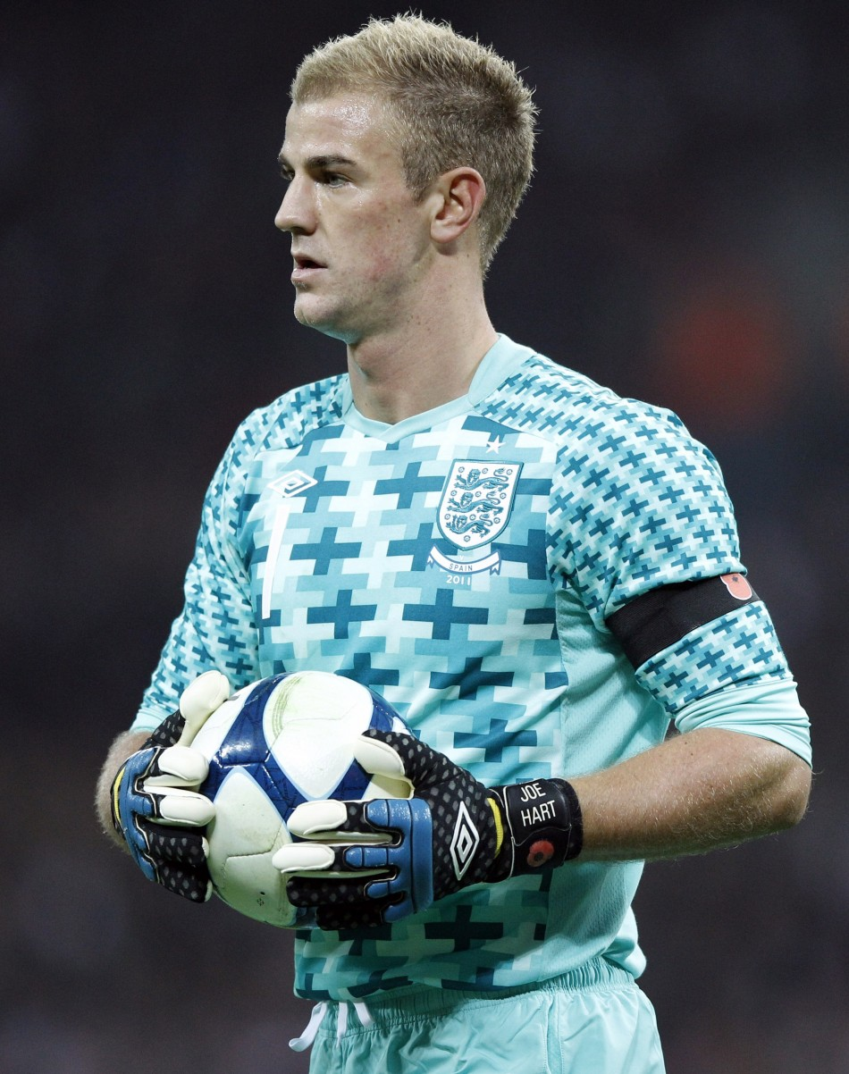 Englands Hart holds the ball during their international friendly soccer match against Spain in London