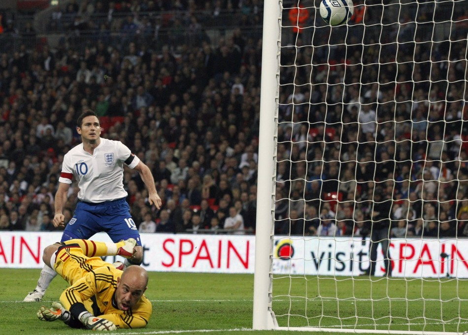 Spain's Reina dives for the ball as it bounces out to England's Lampard to score a goal during their international friendly soccer match at Wembley Stadium in London