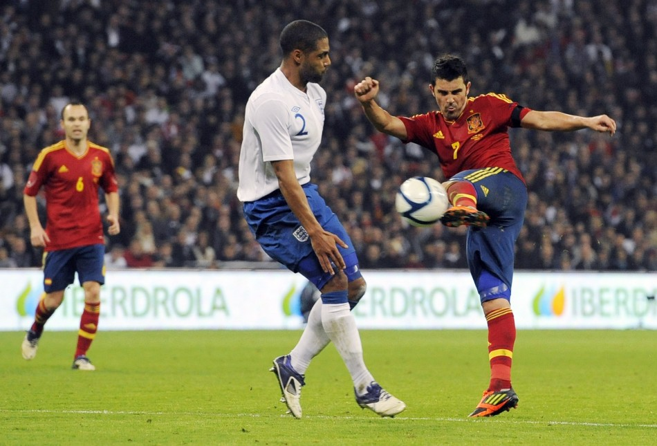 Spains Villa shoots past Englands Johnson during their international friendly soccer match in London