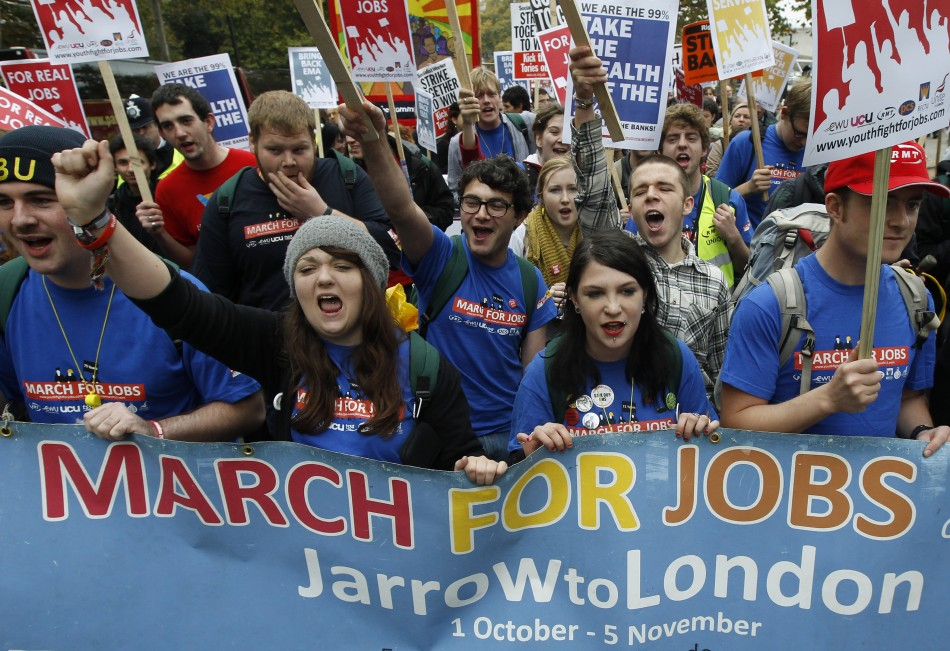 Demonstrators protest against job cuts in central London on November 5, 2011. Many of the demonstrators had marched from Jarrow in north east England, recreating a 1936 protest march against unemployment.