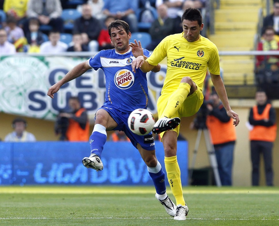 Villarreal's Bruno Soriano and Getafe's Victor Sanchez fight for the ball during their Spanish first division soccer match in Villarreal