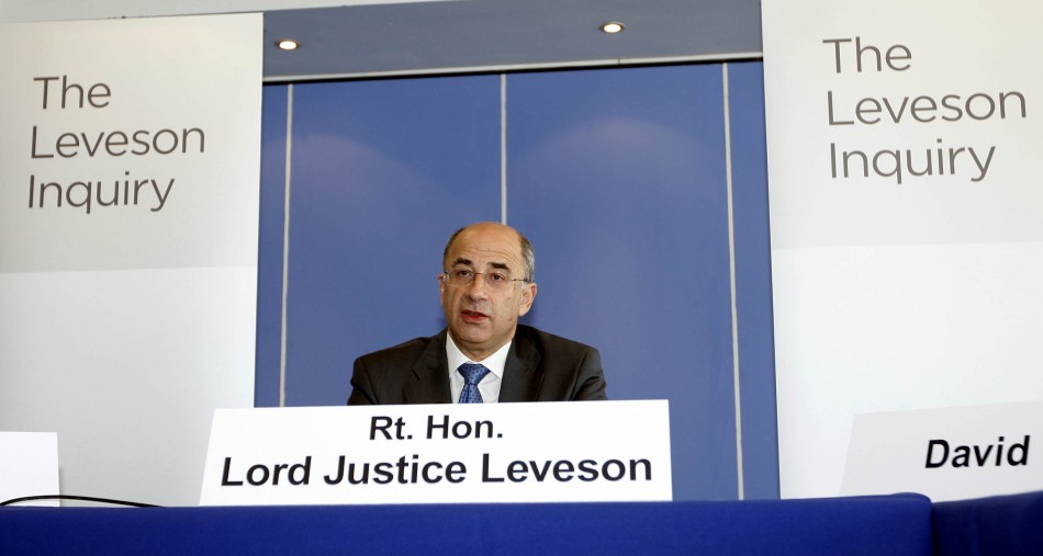 Lord Justice Brian Leveson speaks at the inquiry into alleged phone hacking by the British media, at the Queen Elizabeth II Conference Centre in London