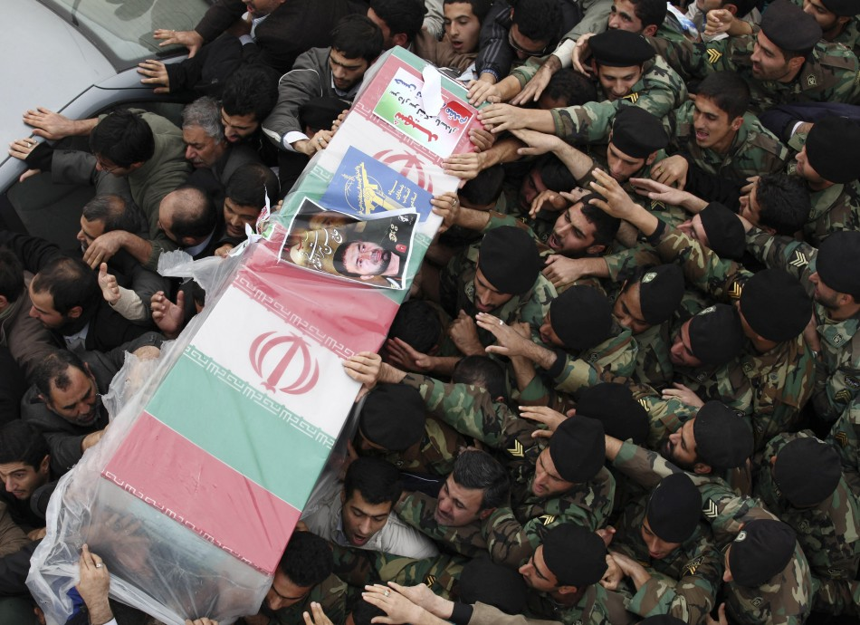 Iranian policemen carry coffin of Tehrani Moghadam, Revolutionary guards commander, who was killed during blast in military base, in Tehran