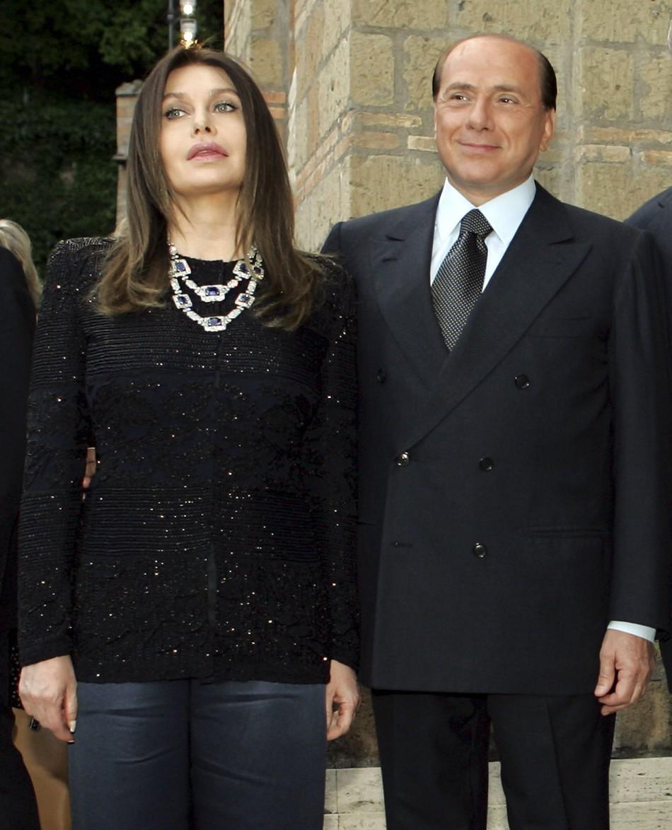 Italy's Prime Minister Silvio Berlusconi and his wife Veronica Lario (L) pose at Villa Madama in Rome in a June 4, 2004 file photo.