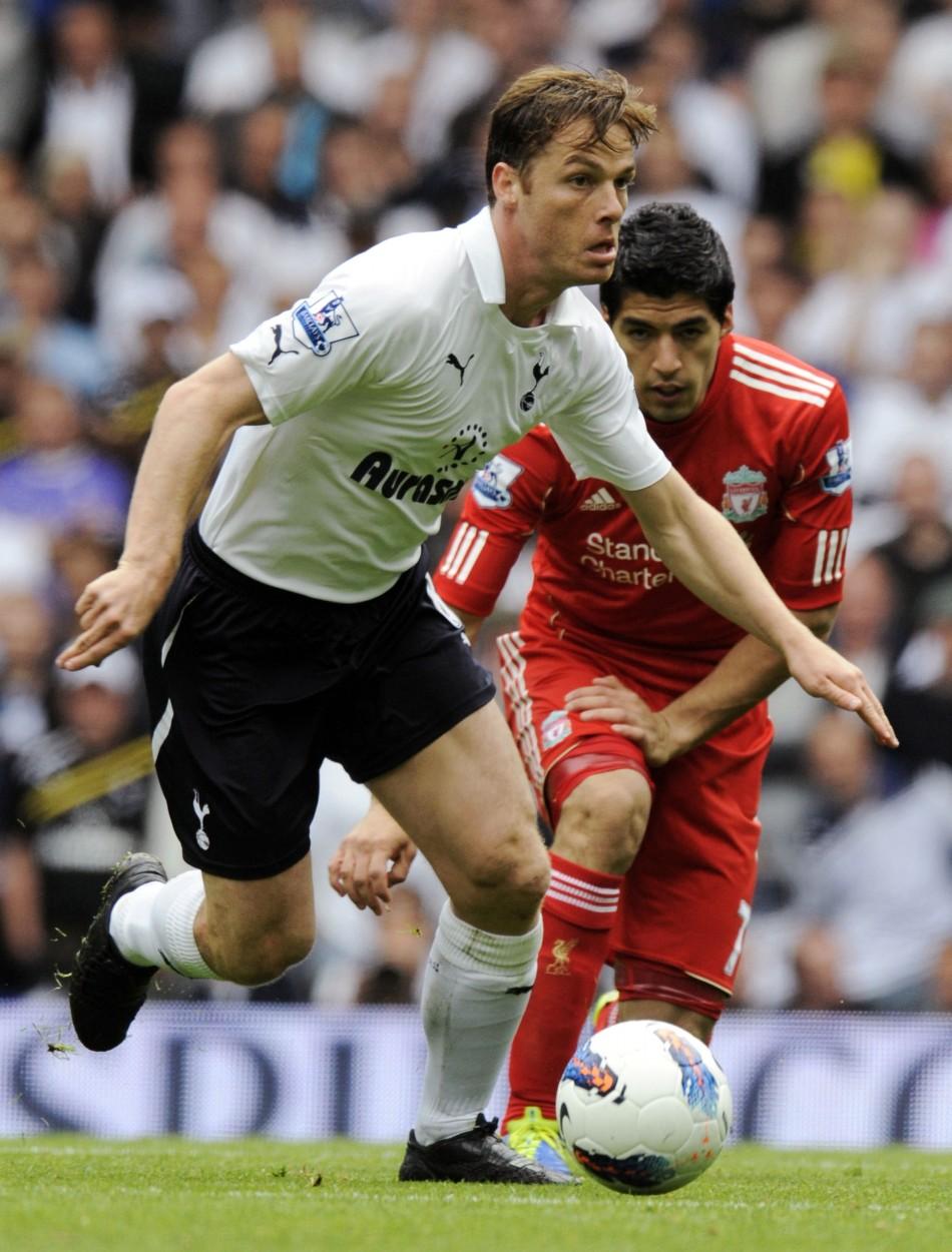 Tottenham Hotspurs Parker gets past Liverpools Suarez during their English Premier League soccer match in London