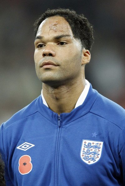 Englands Lescott lines up for the national anthems before their international friendly soccer match against Spain in London