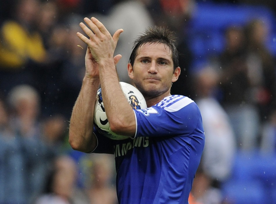 Chelsea's Frank Lampard walks off with the match ball after their English Premier League soccer match against Bolton Wanderers in Bolton
