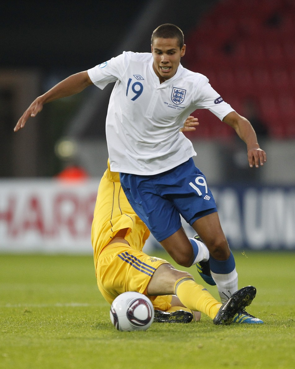 Ukraines Denys Garmash challenges Englands Jack Rodwell during their European Under-21 Championship soccer match in Herning