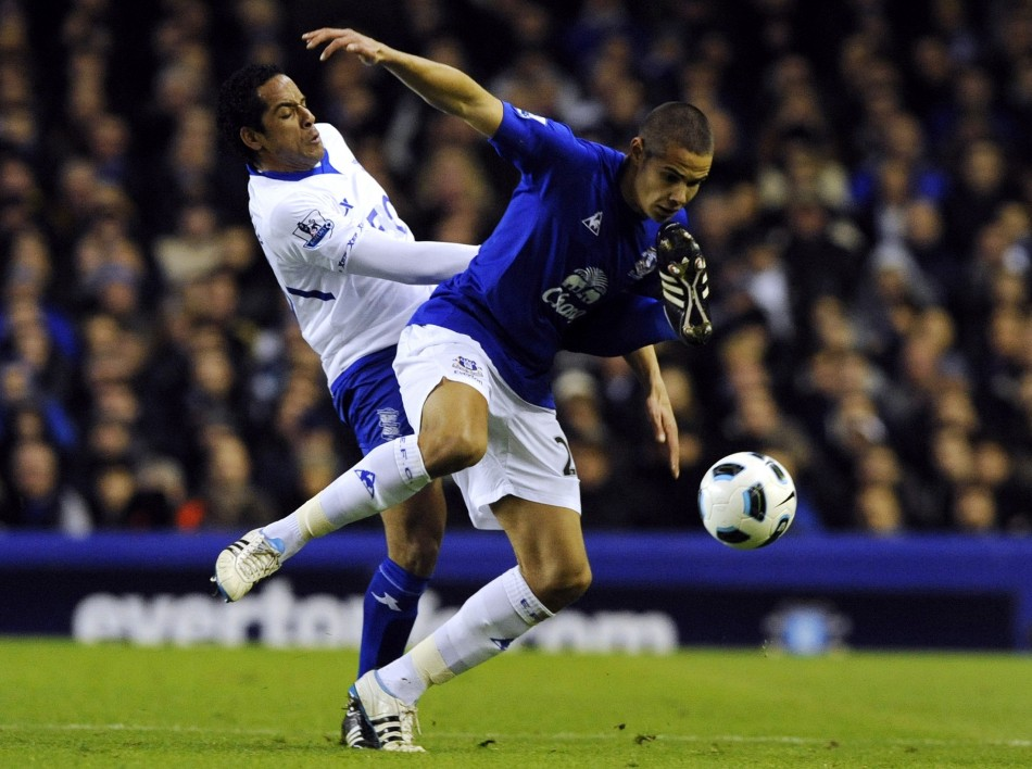 Birmingham City's Beausejour challenges Everton's Rodwell during their English Premier League soccer match in Liverpool