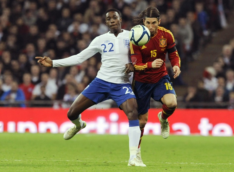 Spain's Ramos and England's Welbeck challenge for the ball during their international friendly soccer match in London