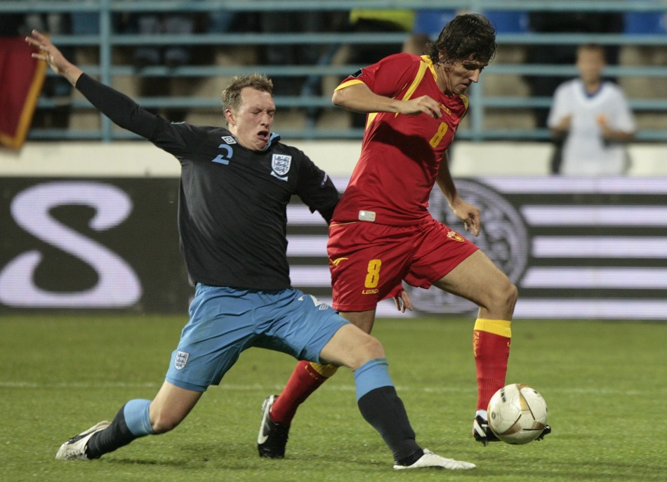 England's Jones challenges Montenegro's Jovetic during their Euro 2012 Group G qualifying soccer match in Podgorica