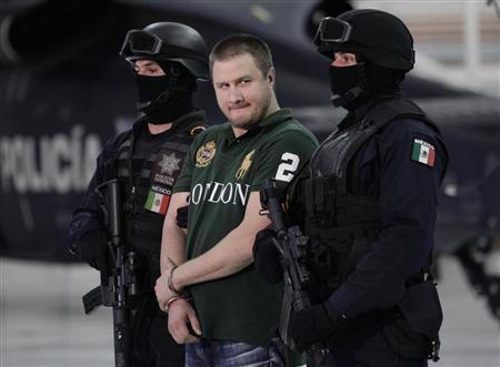"Major drug trafficker Edgar ""La Barbie"" Valdez is escorted by Mexican federal police during a news conference at the federal police center in Mexico City"