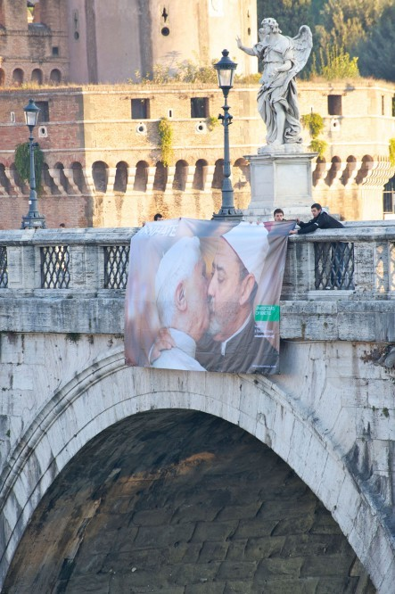 A picture of the Pope embracing one of Islam's leading figures, Ahmed Mohamed el-Tayeb, the imam of the al-Azhar mosque in Egypt, was hung from a bridge near the Vatican early Wednesday.