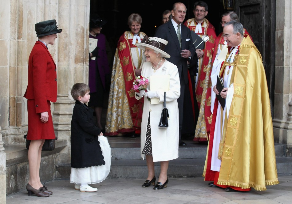 Queen Elizabeth II is given some flowers by Martha Campbell as she leaves a service of celebration to mark the 400th Anniversary of the King James Bible at Westminster Abbey in London.