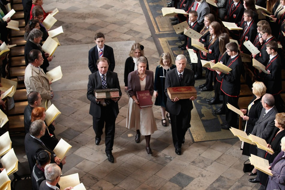 Ancient copies of the King James Bible are carried during a procession to the alter during a service