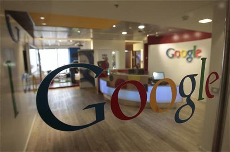 The Google logo is seen on a door at the company's office in Tel Aviv