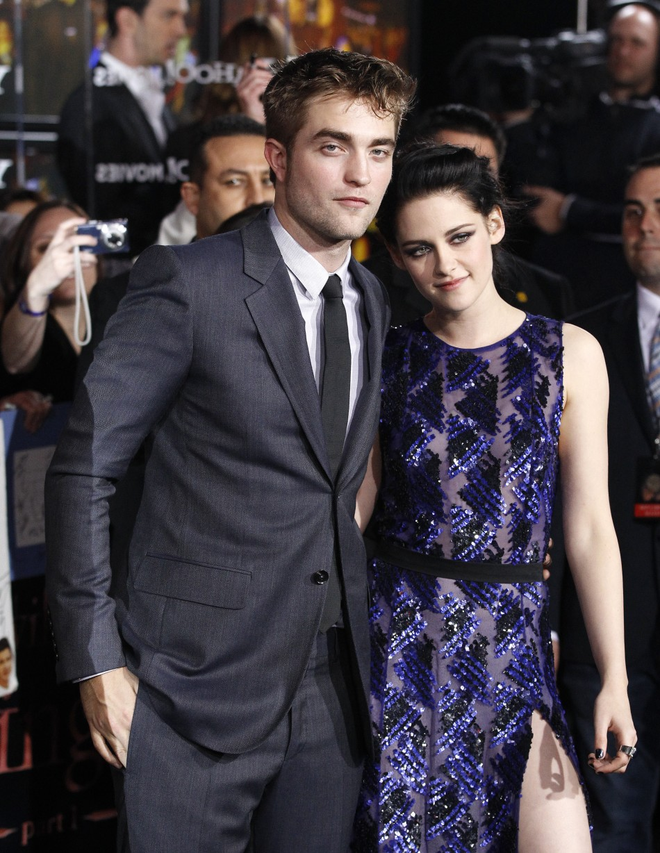 """Cast members Robert Pattinson and Kristen Stewart pose at the premiere of """"The Twilight Saga: Breaking Dawn - Part 1"""" at Nokia Theatre in Los Angeles"""