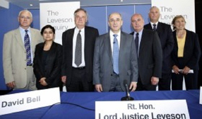 Lord Justice Leveson (centre) and the assessors of his inquiry into culture practices and ethics of the press (from left to right) George Jones, Shami Chakrabarti, David Bell, David Currie, Paul Scott-Lee and Elinor Goodman.