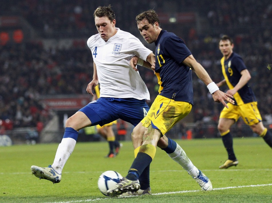 England's Phil Jones challenges Sweden's Johan Elmander during their international friendly soccer match in London