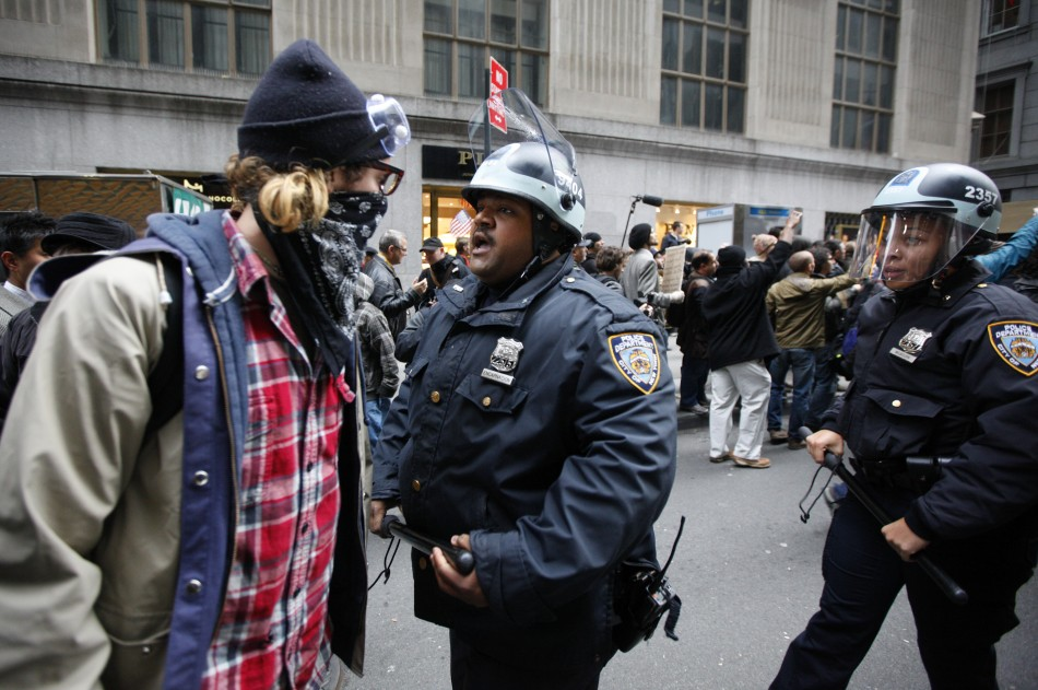 """An Occupy Wall Street demonstrator argues with a New York City Police officer during what protest organizers call a """"Day of Action"""" in New York"""