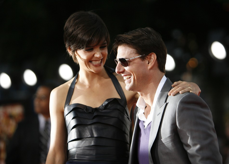 Cruise and his wife actress Holmes smile as they arrive at the premiere of Tropic Thunder at the Manns Village theatre in Westwood