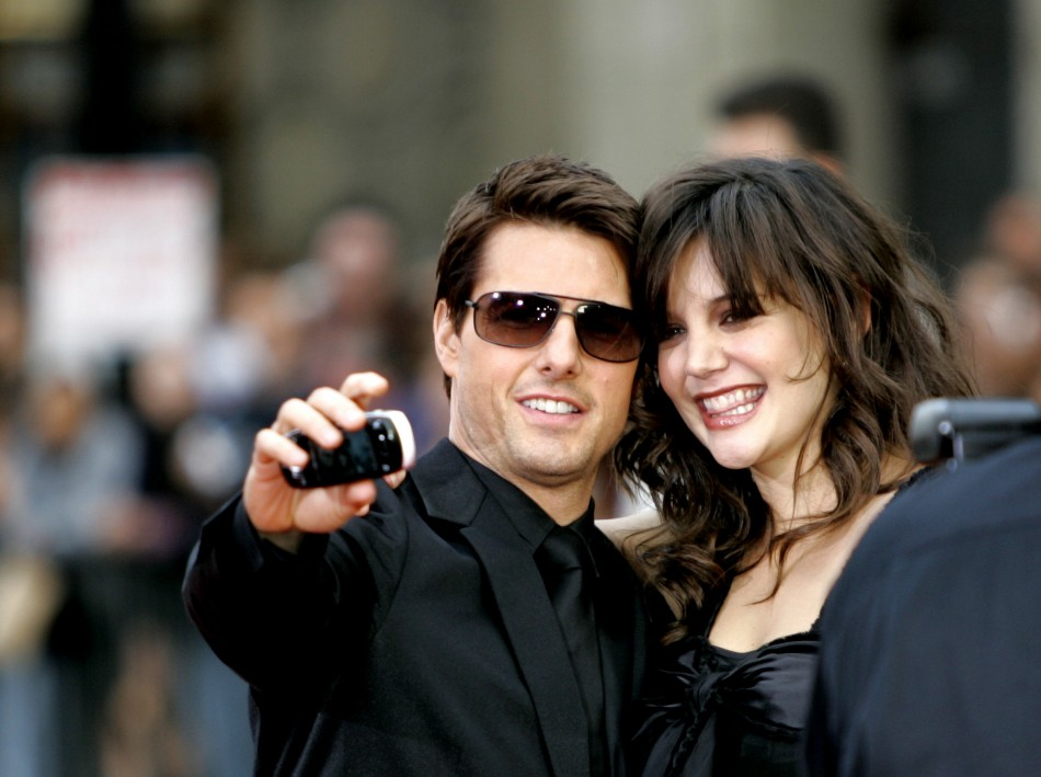 Cast member Tom Cruise takes a self-portrait with his fiancee actress Katie Holmes at the screening of quotMission Impossible IIIquot