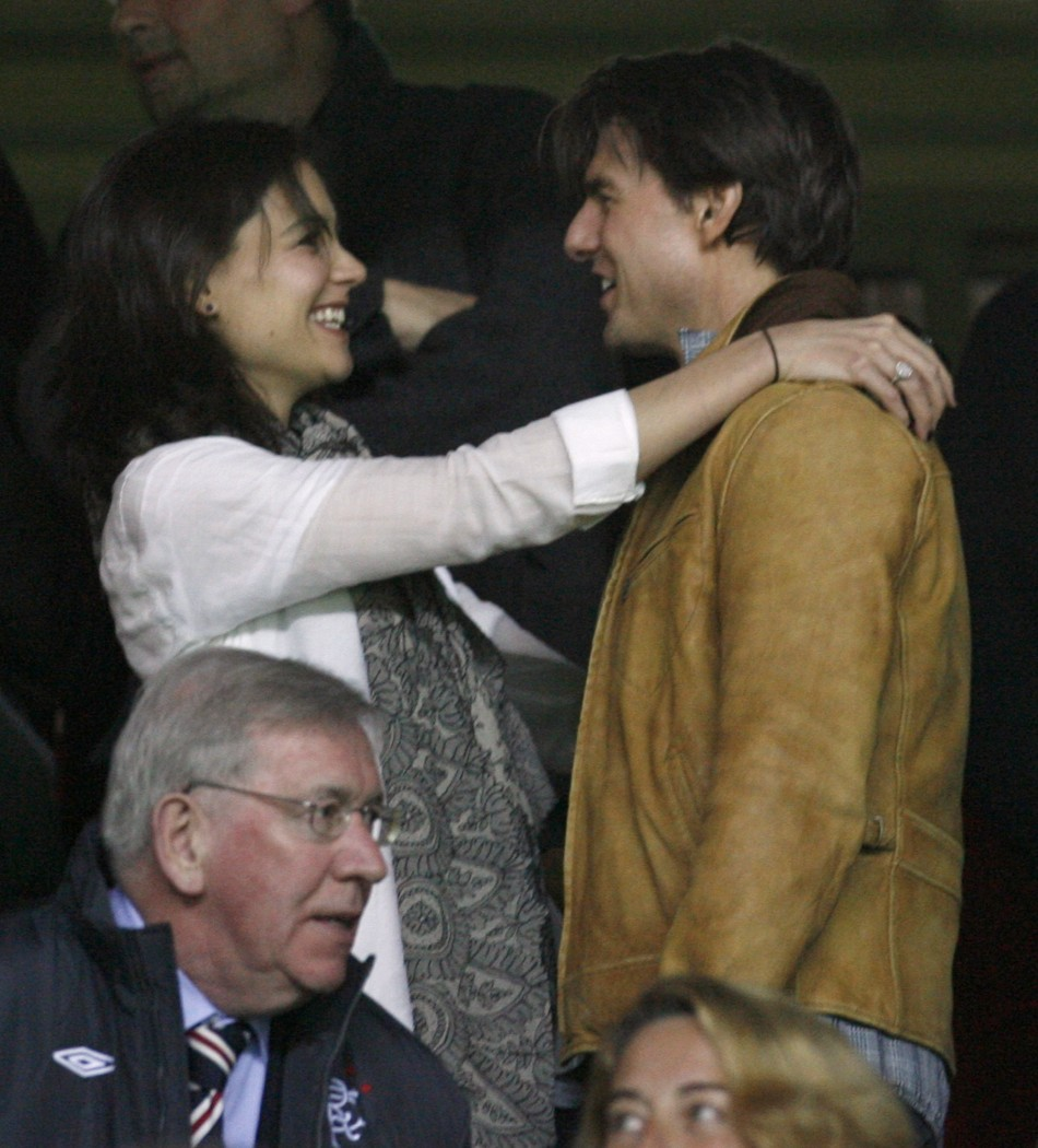Tom Cruise is hugged by wife Katie Holmes before Champions League soccer match between Sevilla and Rangers in Seville