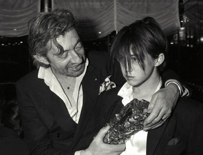 Serge Gainsbourg and his daughter Charlotte pose with Cesar award after the ceremonies in Paris February 23, 1986.