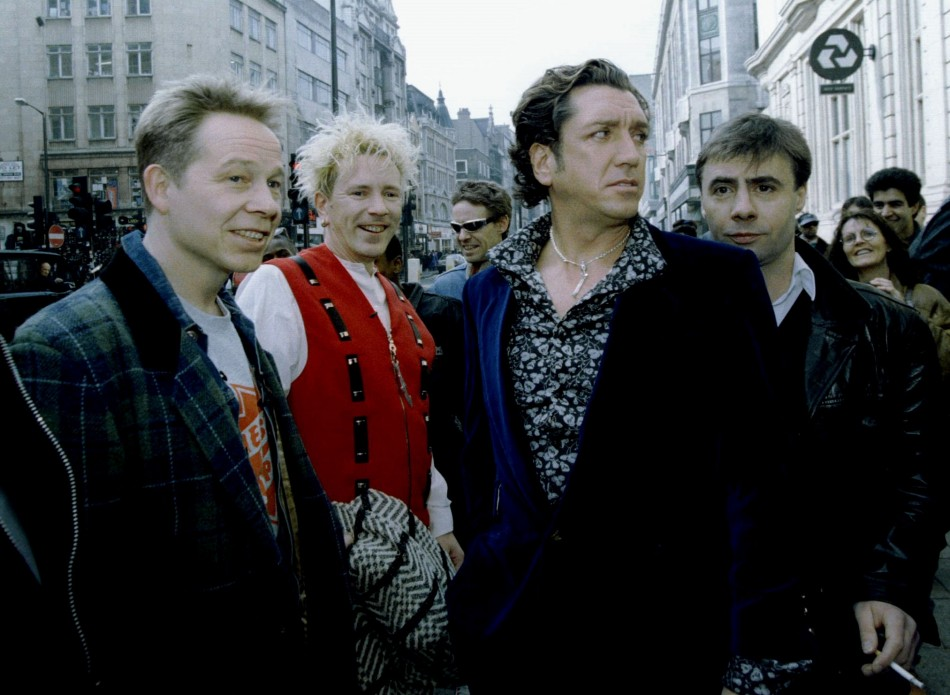 The four original members of the Sex pistols (L-R) Paul Cook, Johnny Rotten, Steve Jones, and Glen Matlock arrive at a press conference at the 100 Club in central London, March 18