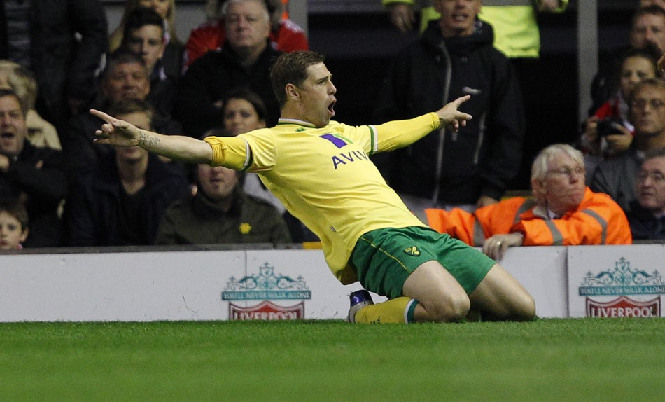 Norwich City's Holt celebrates after scoring during their English Premier League soccer match against Liverpool at Anfield in Liverpool