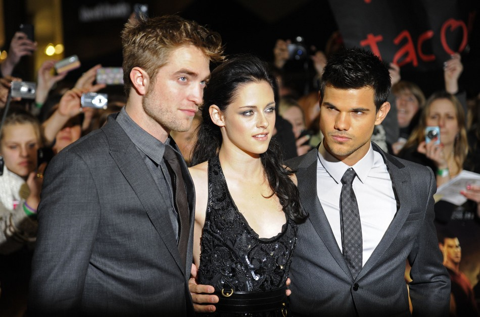 Actors Pattinson Stewart and Lautner arrive for the British premiere of 'The Twilight Saga: Breaking Dawn' at Westfield in east London