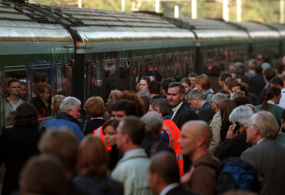 People waiting to board a train